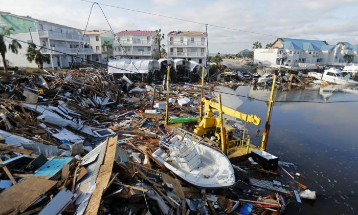 In this file photo, a boat sits amidst debris in the aftermath of Hurricane Michael in Mexico Beach, Fla. on Oct. 11, 2018. Weather forecasters have posthumously upgraded last fall's Hurricane Michael from a Category 4 storm to a Category 5.  (Gerald Herbert/AP Photo, File)