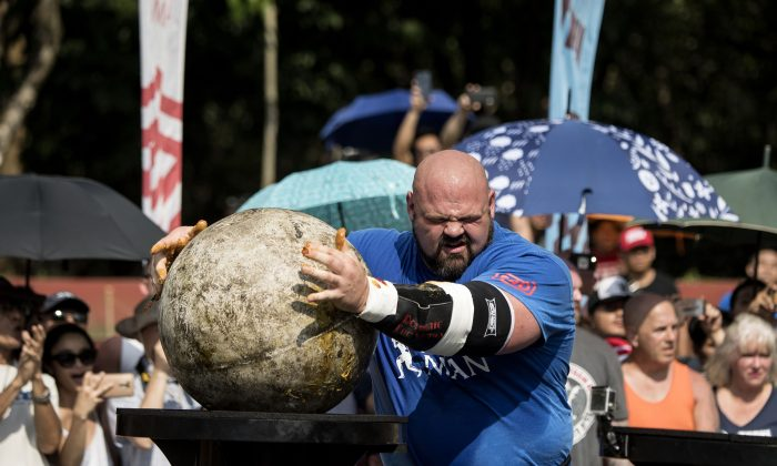 Brian Shaw of the United States lifts a concrete sphere during the Atlas Stones competition of the 2018 World's Strongest Man in Manila, Philippines, on May 6, 2018.  (Noel Celis/AFP/Getty Images)