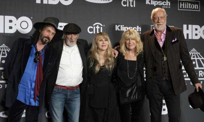 Inductee Stevie Nicks, center, posing with other members of Fleetwood Mac at the Rock & Roll Hall of Fame induction ceremony in New York on March 29, 2019. Fleetwood Mac has announced rescheduled dates for its North America tour which were postponed earlier this month because singer Stevie Nicks had the flu. (Charles Sykes/Invision/AP, File)