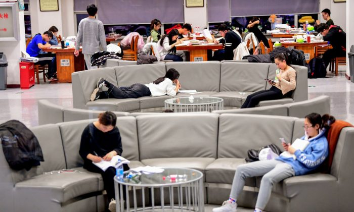 This photo taken on December 18, 2018 shows university students preparing for the upcoming National Entrance Examination for Postgraduate (NEEP) at a library of Shenyang Agricultural University in Shenyang in China's northeastern Liaoning province. (STR/AFP/Getty Images)