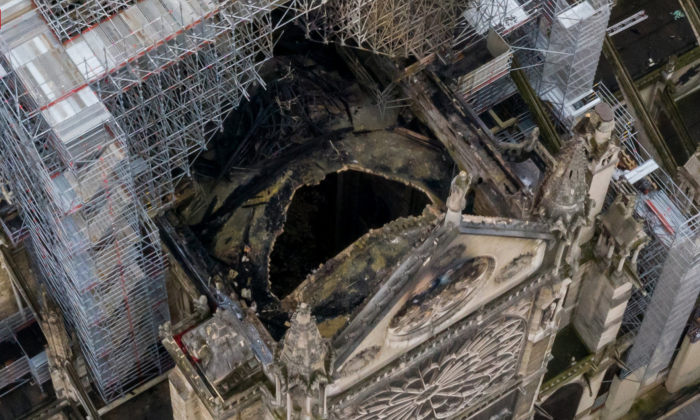 An aerial shot of the fire damage to Notre Dame cathedral in Paris on April 16, 2019. (Gigarama.ru)