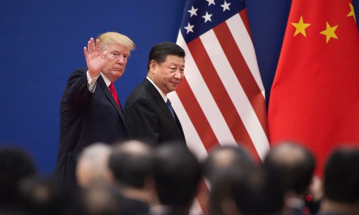 U.S. President Donald Trump (L) and Chinese leader Xi Jinping leave a business leaders event at the Great Hall of the People in Beijing on Nov. 9, 2017. (Nicolas Asfouri/AFP/Getty Images)