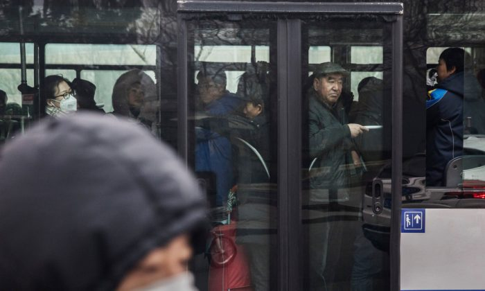 People on a full bus in China. (Kevin Frayer/Getty Images)