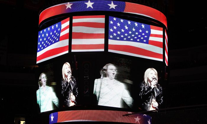 Singers Kate Smith, left, and Lauren Hart sing at the 2010 NHL Stanley Cup Final mat the Wachovia Center in Philadelphia, Pennsylvania on June 9, 2010. (Andre Ringuette/Getty Images)