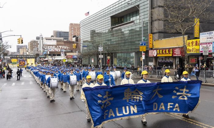 20 years after practitioners in China first appealed to the Chinese regime for their right to practice, New York Falun Gong practitioners call for an end to the persecution with a commemoration parade in Flushing, Queens, New York City, on April 20, 2019. (Edward Dai/The Epoch Times)
