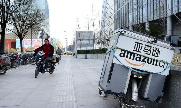 An electric delivery bike used by Amazon sits parked along the pavement at a central business district in Beijing on Nov. 29, 2012. (Wang Zhao/AFP/Getty Images)