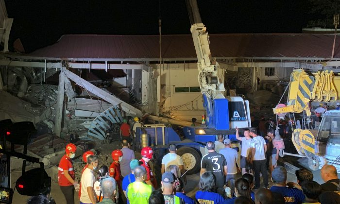 Workers continue rescue efforts on people still trapped inside a collapsed building at Porac town, Philippines on April 22, 2019. A strong 6.1 magnitude earthquake trapped some people in a collapsed building, damaged an airport terminal and knocked out power in at least one province, officials said. AP Photo/Bullit Marquez