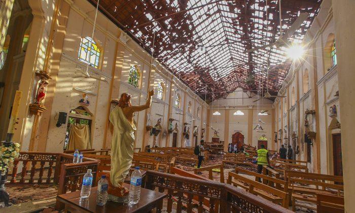A view of St. Sebastian's Church damaged in blast in Negombo, north of Colombo, Sri Lanka, Sunday, April 21, 2019/ (AP Photo/Chamila Karunarathne)