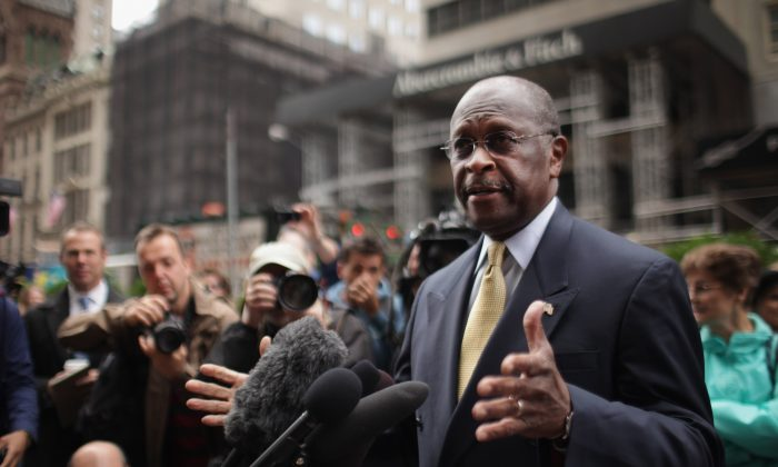 Herman Cain speaks to the media outside of Trump Towers before a scheduled appearance with real estate mogul Donald Trump on October 3, 2011 in New York City. (Spencer Platt/Getty Images)