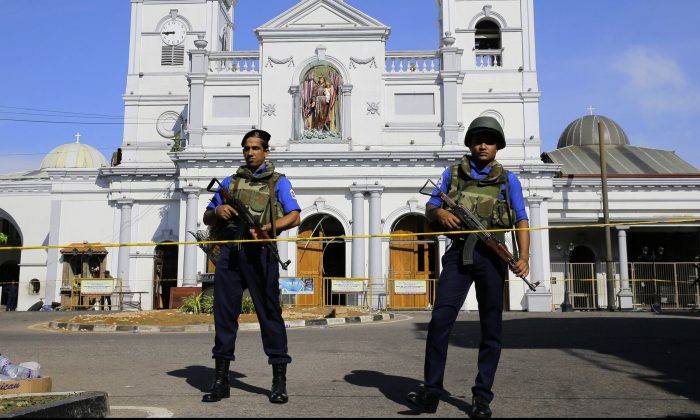 Sri Lankan Navy soldiers stand guard in front of the St. Anthony's Shrine a day after the series of blasts, in Colombo, Sri Lanka, Monday, April 22, 2019. Easter Sunday bombings of churches, luxury hotels and other sites that killed hundreds of people was Sri Lanka's deadliest violence since a devastating civil war in the South Asian island nation ended a decade ago. (Eranga Jayawardena/AP Photo)
