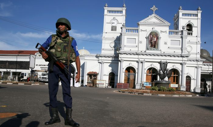 A security officer stands in front of St. Anthony's shrine in Colombo, after bomb blasts ripped through churches and luxury hotels in Sri Lanka, on April 22, 2019. (Athit Perawongmetha/Reuters)