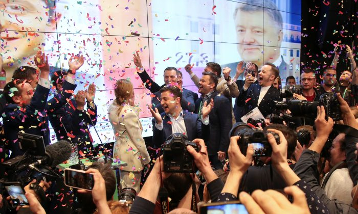 Ukrainian presidential candidate Volodymyr Zelenskiy and his team members react following the announcement of the first exit poll in a presidential election at his campaign headquarters in Kiev, Ukraine, on April 21, 2019. (Viacheslav Ratynskyi/Reuters)