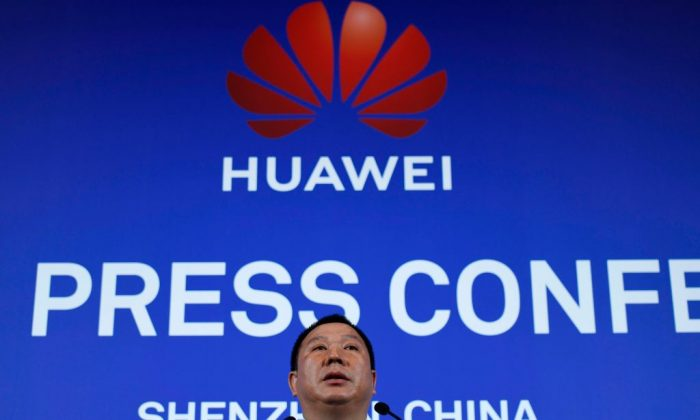 Huawei's Chief Legal Officer Song Liuping speaks during a press conference in Shenzhen, China's Guangdong province on March 7, 2019. - Chinese telecom giant Huawei said on March 7 it was suing the United States for barring government agencies from buying the telecom company's equipment and services. (WANG ZHAO/AFP/Getty Images)