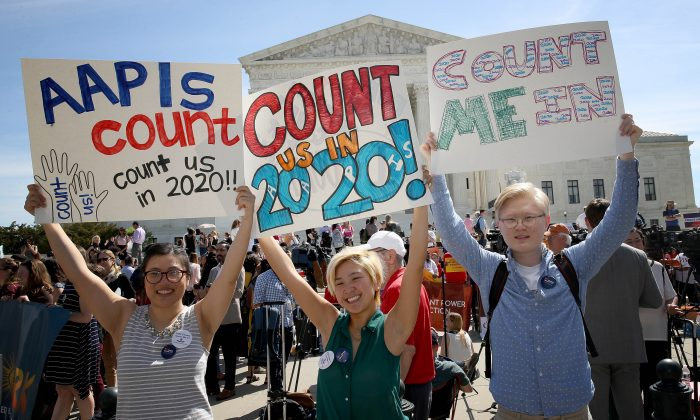 Protesters gather outside the U.S. Supreme Court as the court hears oral arguments in the Commerce v. New York case in Washington on April 23, 2019. Win McNamee/Getty Images