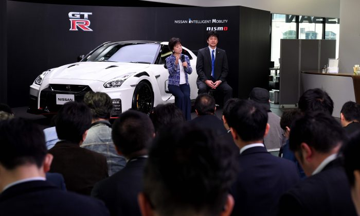 Nissan senior vice president Asako Hoshino (L) and corporate vice president Kinichi Tanuma (R) hold a question and answer session in front of the 2020 model of the Nissan GT-R NISMO at Nissan Crossing, the company's flagship showroom, during a promotional event in Tokyo on April 17 2019. (Toshifumi Kitamura/AFP/Getty Images)