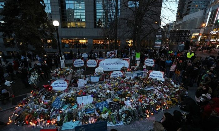 Candles surround a makeshift memorial in Mel Lastman Square in Toronto for the victims of the van attack before a vigil on April 29, 2018.  (Lars Hagberg/AFP/Getty Images)