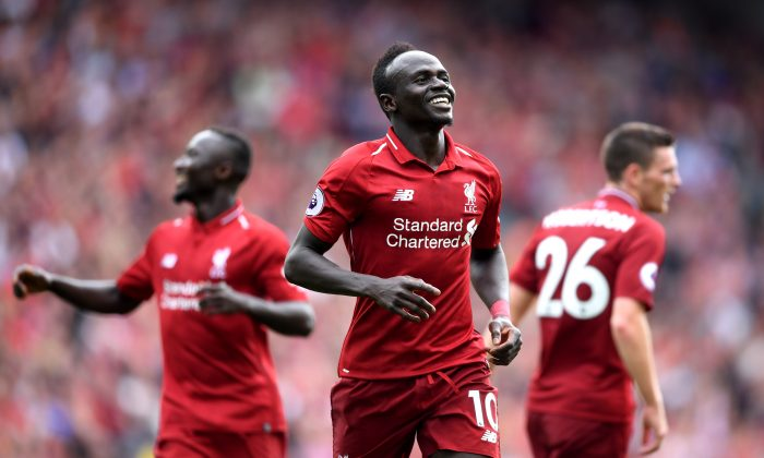 Sadio Mane of Liverpool celebrates after scoring his team's third goal during the Premier League match between Liverpool FC and West Ham United at Anfield on Aug. 12, 2018 in Liverpool, United Kingdom.  (Laurence Griffiths/Getty Images)
