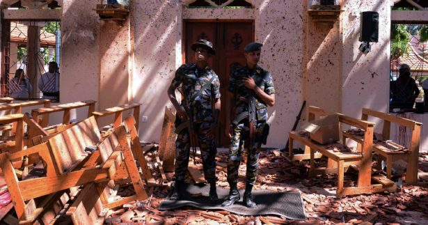 Sri Lankan military stand guard inside a church after an explosion in Negombo, Sri Lanka, on April 21, 2019. (Stringer/Reuters)