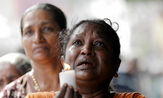 Sri Lanka Detains Syrian in Investigation of Blasts, Toll Rises to 321