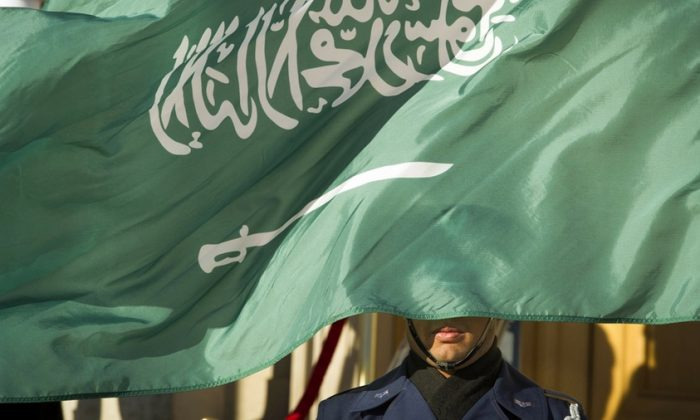 This file picture shows a flag of Saudi Arabia. Saudi Arabia's Interior Ministry said that 37 Saudi citizens have been beheaded in a mass execution that took place across various regions of the country, on April 23, 2019. (Cliff Owen/AP Photo, File)