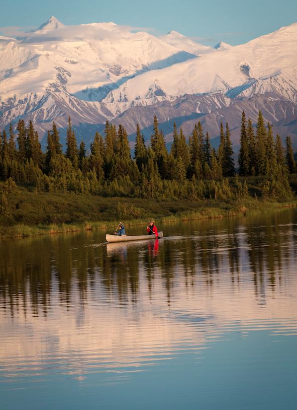 Denali National Park visitors paddle through Wonder Lake.