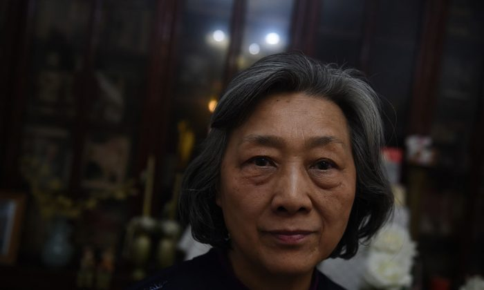 """Veteran Chinese journalist Gao Yu poses for a photo at her home in Beijing on March 31, 2016. She was jailed for """"leaking state secrets"""" in a case that drew international condemnation and spoke out on March 31 for the first time since her release on medical parole. (GREG BAKER/AFP/Getty Images)"""