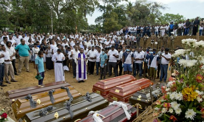 Mass burial for Easter Sunday bomb blast victims in Negombo, Sri Lanka, on April 24, 2019. (Gemunu Amarasinghe/Photo via AP)