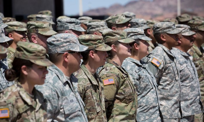 Members of the Arizona National Guard listen to instructions at the Papago Park Military Reservation in Phoenix, on April 9, 2018. (Caitlin O'Hara/ /AFP/Getty Images)