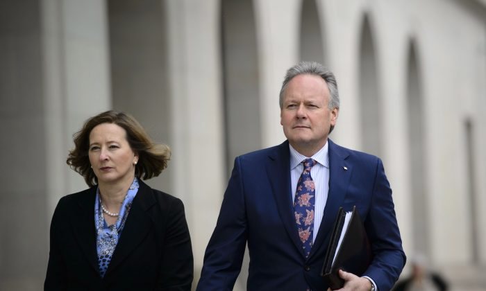 Bank of Canada governor Stephen Poloz and senior deputy governor Carolyn Wilkins make their way to a press conference at the National Press Theatre in Ottawa on April 24. The central bank held its key policy rate at 1.75 percent. (The Canadian Press/Sean Kilpatrick)