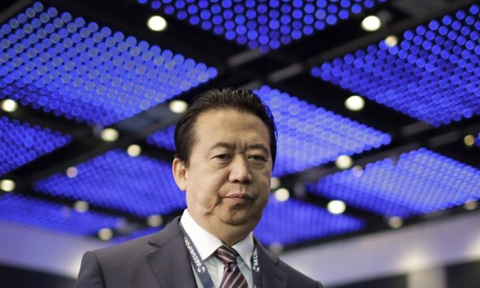 Interpol President, Meng Hongwei, walks toward the stage to deliver his opening address at the Interpol World congress in Singapore on July 4, 2017.  (Wong Maye/AP)