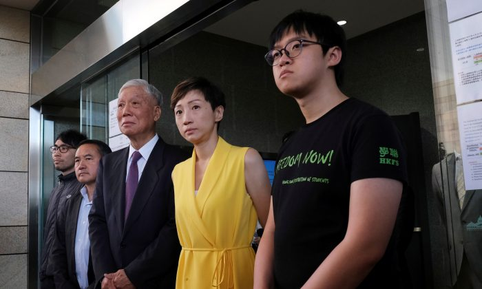 "(L-R) Pro-democracy activists Chung Yiu-wa, Lee Wing-tat, Chu Yiu-ming, Tanya Chan and Cheung Sau-yin leave the court after getting their suspended sentence on their involvement in the Occupy Central, also known as ""Umbrella Movement,"" in Hong Kong, China on April 24, 2019. (Tyrone Siu/Reuters)"