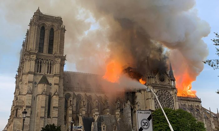Flames and smoke are seen billowing from the roof at Notre-Dame Cathedral in Paris on April 15, 2019. A fire broke out at the landmark Notre-Dame Cathedral in central Paris, potentially involving renovation works being carried out at the site, the fire service said. (Patrick Anidjar/AFP/Getty Images)