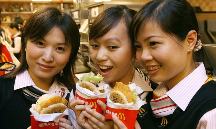 Workers at a McDondald's in Hong Kong. (Mike Clarke/AFP/Getty Images)