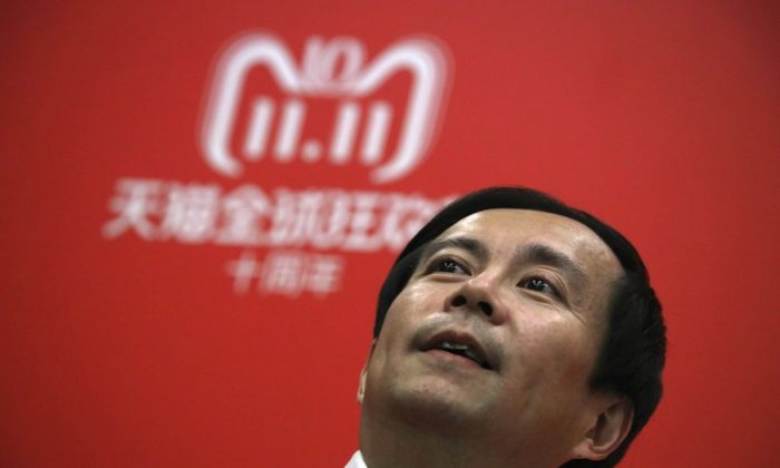 """Daniel Zhang, CEO of Alibaba Group speaks to journalists during Alibaba's Singles Day in Shanghai, China on Nov. 11, 2018. Chinese e-commerce giant Alibaba Group remains on the U.S. government's annual list of """"notorious markets'' that peddle counterfeit products. (Ng Han Guan/AP)"""