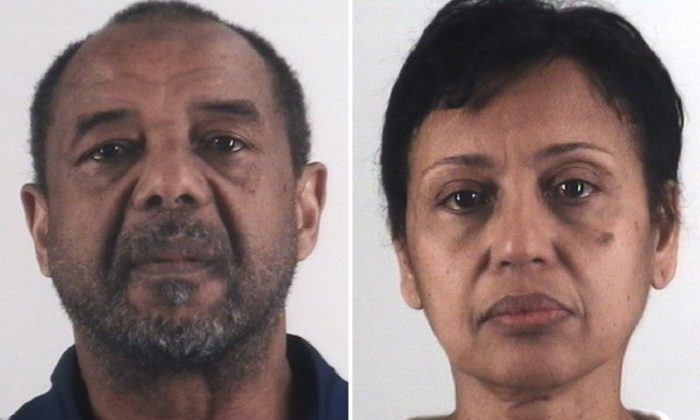 Mohamed Toure (L) and Denise Cros-Toure, a Fort Worth couple accused of enslaving a Guinean woman for 16 years. (Tarrant County Sheriff's Department via AP)