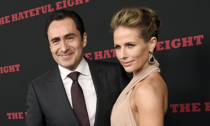"Demian Bichir, a cast member in ""The Hateful Eight,"" and his wife Stefanie Shirk at the premiere of the film in Los Angeles on Dec. 7, 2015. (Chris Pizzello/Invision/AP, File)"