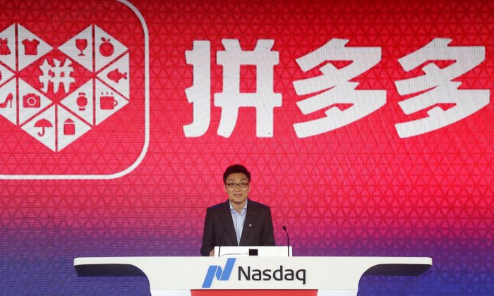 Colin Huang, founder and CEO of the online group discounter Pinduoduo, speaks during the company's stock trading debut at the Nasdaq Stock Market in New York, during an event in Shanghai, China on July 26, 2018.   (Yin Liqin/CNS via Reuters)