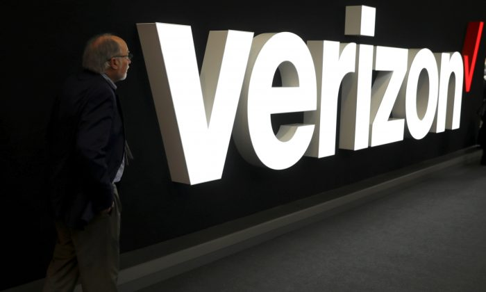 A man stands next to the logo of Verizon at the Mobile World Congress in Barcelona, Spain, Feb. 26, 2019. (Sergio Perez/Reuters)
