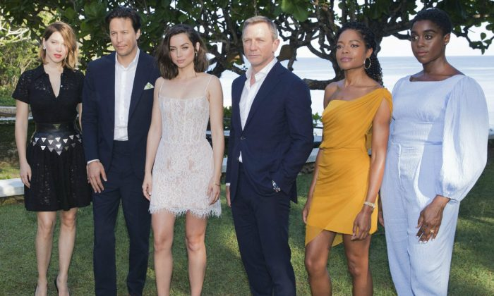 Actress Lea Seydoux, from (L), director Cary Joji Fukunaga, actors Ana de Armas, Daniel Craig, Naomie Harris and Lashana Lynch pose for photographers during the photo call of the latest installment of the James Bond film franchise, currently known as 'Bond 25', in Oracabessa, Jamaica, on Apr. 25, 2019. (Leo Hudson/AP Photo)