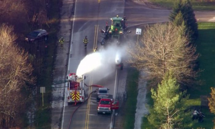 A leak in a tractor-trailer carrying anhydrous ammonia caused a chemical spill in Beach Park, Illinois, on April 25, 2019. (WGN via CNN)