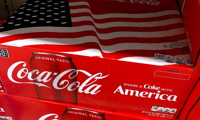 Cases of Coca Cola are displayed on a grocery store shelf in San Rafael, Calif. on July 25, 2018. (Justin Sullivan/Getty Images)