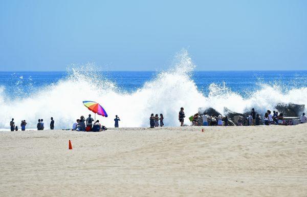 Giant waves crash into the rocks at Venice Beach