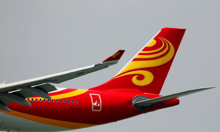 A Hong Kong Airlines Airbus A330-300 descends before landing at Hong Kong Airport in Hong Kong, China on April 4, 2018. (Bobby Yip/Reuters)