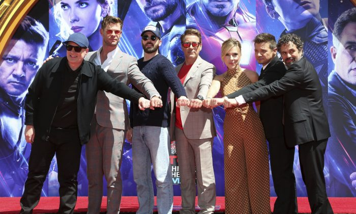 "Marvel Studios President Kevin Feige, from left, poses with members of the cast of ""Avengers: Endgame,"" Chris Hemsworth, Chris Evans, Robert Downey Jr., Scarlett Johansson, Jeremy Renner and Mark Ruffalo at a hand and footprint ceremony at the TCL Chinese Theatre on April 23, 2019, in Los Angeles. (Willy Sanjuan/Invision/AP)"