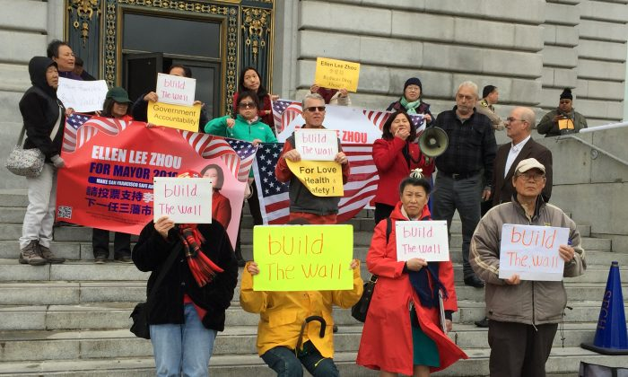 Ellen Zhou and her supporters on the steps in front of San Francisco City Hall on Feb. 25, 2019. (The Epoch Times)