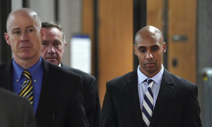 Former Minneapolis police officer Mohamed Noor, right, with attorneys Peter Wold, center, and Thomas Plunkett, left, walks out of the the Hennepin County Government Center on April 25, 2019. (Brian Peterson/Star Tribune/AP)