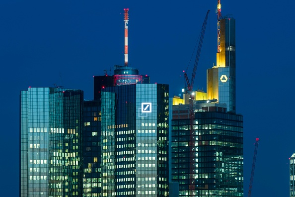 The corporate headquarters of Deutsche Bank (C) and Commerzbank (back, R) in the financial district in Frankfurt, Germany, on March 20, 2019. Thomas Lohnes/Getty Images