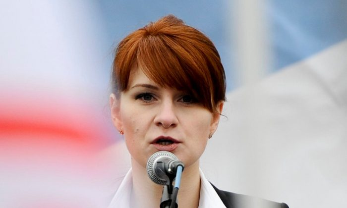 Maria Butina, leader of a pro-gun organization in Russia, speaks to a crowd during a rally in support of legalizing the possession of handguns in Moscow, Russia on April 21, 2013. (AP Photo)