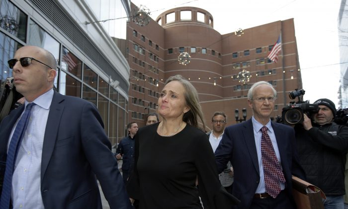 District Court Judge Shelley M. Richmond Joseph (C) departs federal court in Boston, on April 25, 2019, after facing obstruction of justice charges for allegedly helping a man in the country illegally evade immigration officials as he left her Newton, Mass., courthouse after a hearing in 2018. (Steven Senne/AP Photo)