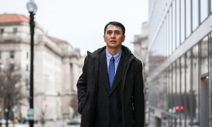 Businessman Yu Ming in Washington on Feb. 19, 2019. He arrived in the United States to join his wife and daughter in Jan. 2019 through the help of the U.S. government, after being imprisoned for 12 years and tortured nearly to death in labor camps in China for his beliefs in Falun Gong. (Samira Bouaou/The Epoch Times)